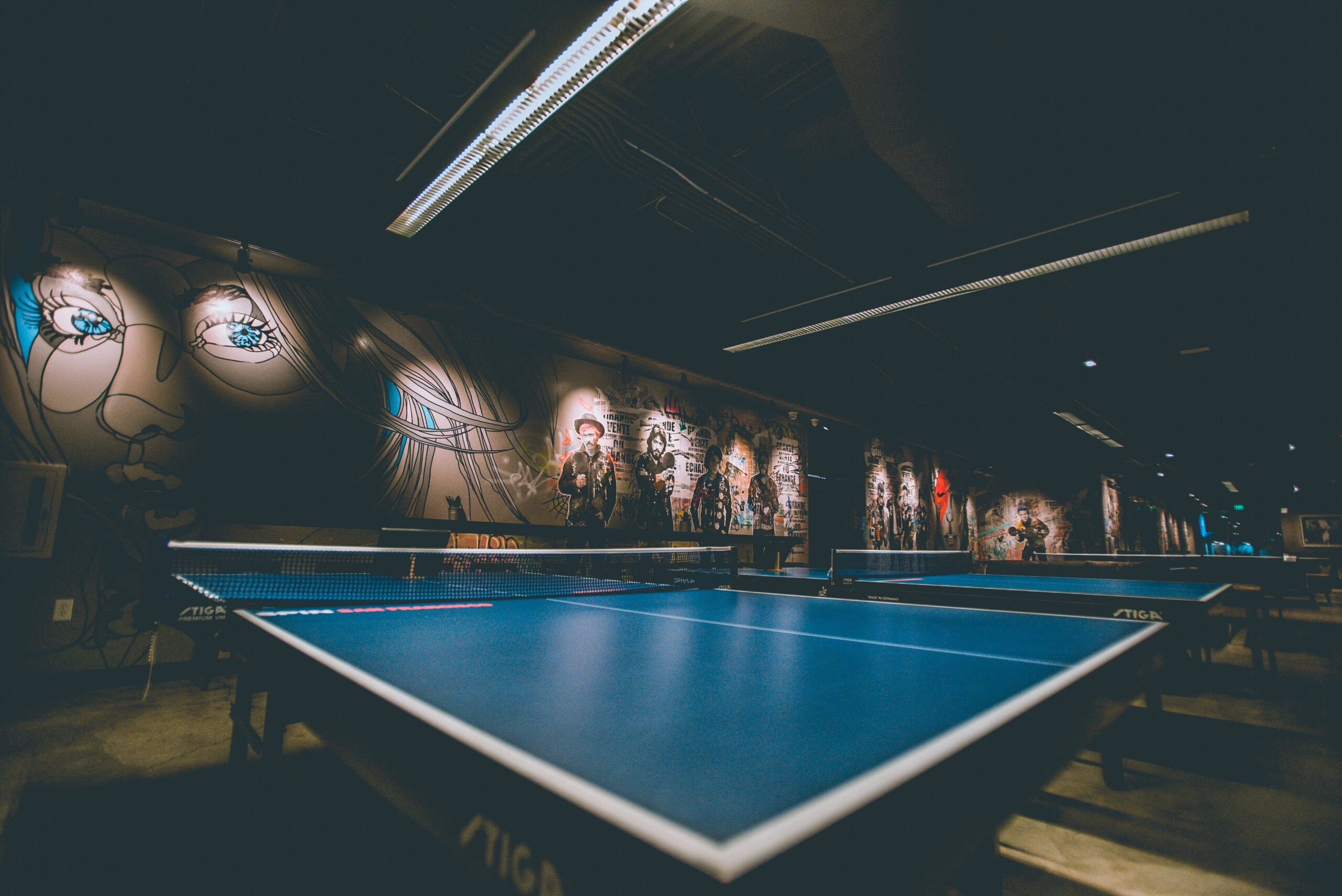 selective focus of blue ping-pong tables